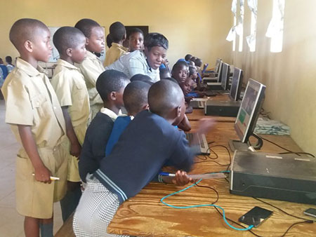 School children in Zimbabwe explore computers donated by the Macheke Sustainability Project